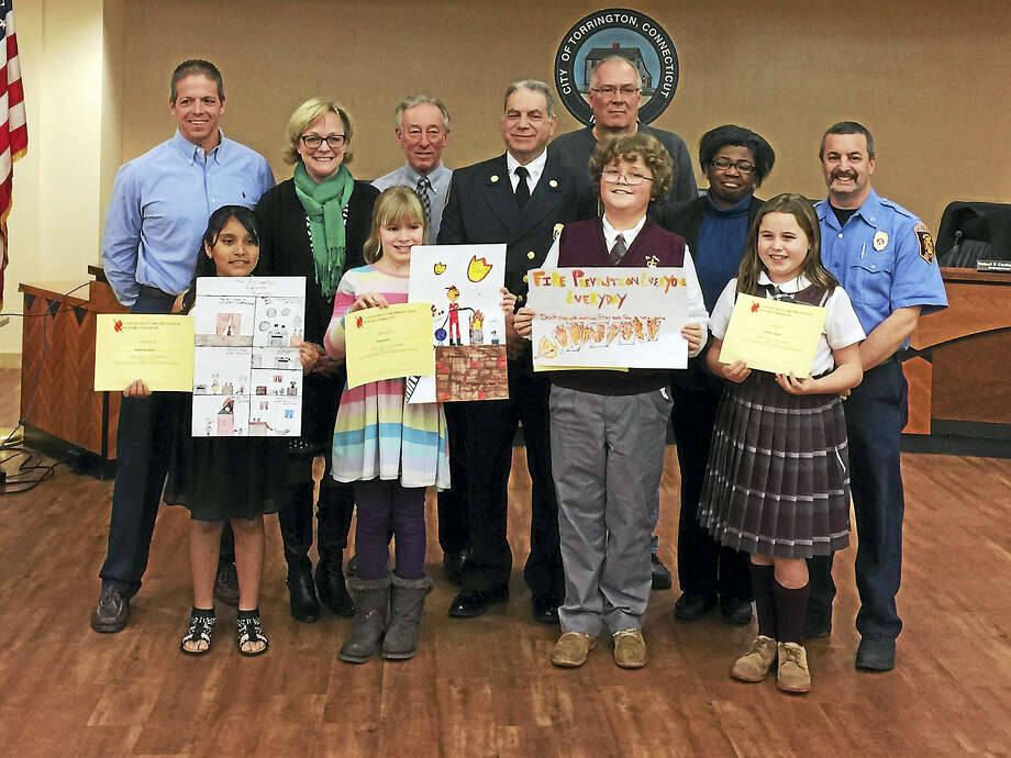 Ben Lambert - The Register CitizenThe winners of the annual Fire Prevention poster contest pose with city officials Wednesday in Torrington. Photo: Digital First Media