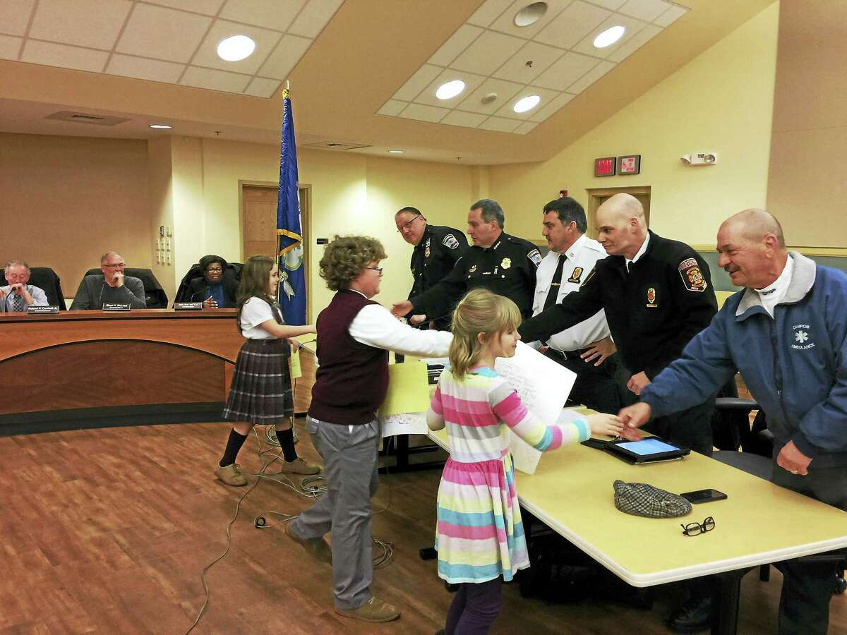 Ben Lambert - The Register Citizen The winners of the annual Fire Prevention poster contest are congratulated by city officials on Wednesday night.