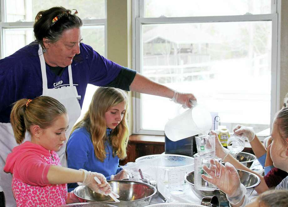 Contributed photosLisa Coyne, a cook at Camp Jewell, teaches a group of Girl Scouts to make bread. Photo: Digital First Media
