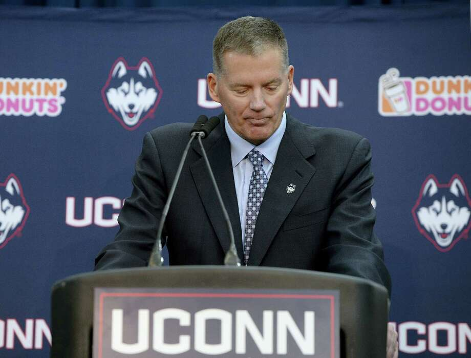 New Connecticut football head coach Randy Edsall pauses while apologizing for the way he left the UConn football program during an NCAA college football news conference at Pratt & Whitney Stadium at Rentschler Field, Friday, Dec. 30, 2016, in East Hartford, Conn. Edsall, the most successful coach in UConn football history, is returning to the Huskies to try and right the ship one more time.  (AP Photo/Jessica Hill) Photo: AP / AP2016