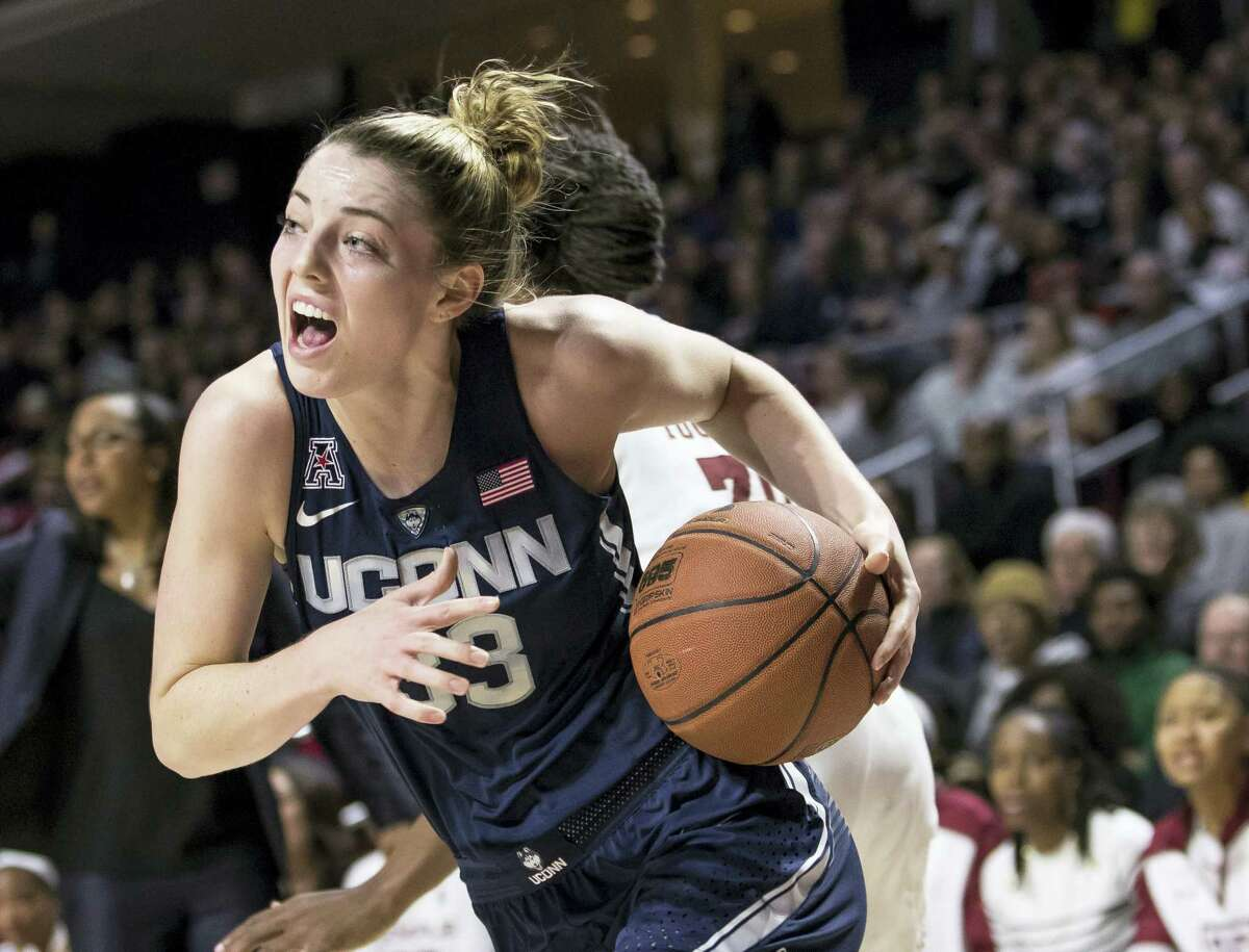 Connecticut's Katie Lou Samuelson, left, drives to the basket against Temple's Donnaizha Fountain, right, during the first half Wednesday in Philadelphia.