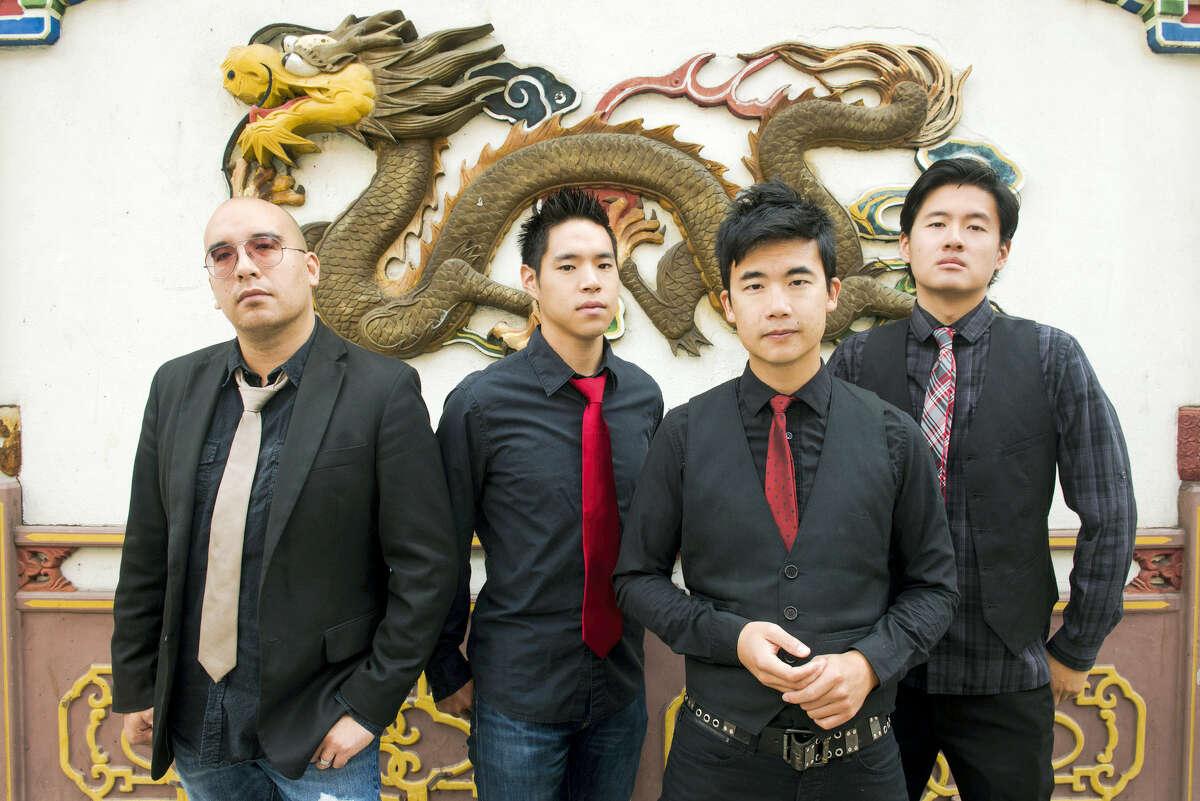 "The Asian-American band The Slants, from left, Joe X Jiang, Ken Shima, Tyler Chen and Simon ""Young"" Tam."