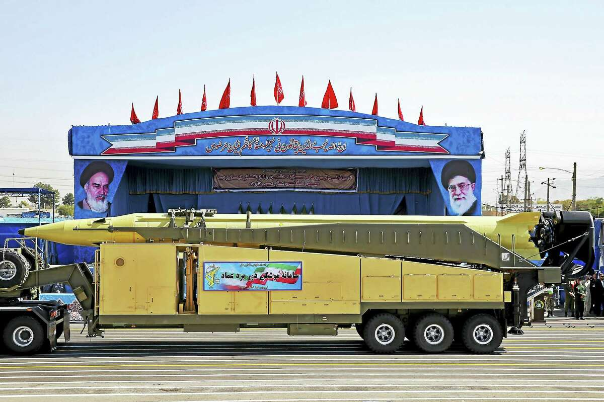 An Emad long-range ballistic surface-to-surface missile is displayed by the Revolutionary Guard during a military parade, in front of the shrine of late revolutionary founder Ayatollah Khomeini, just outside Tehran, Iran. At a joint news conference Tuesday, Jan. 31, 2017, with his visiting French counterpart Jean-Marc Ayrault, Iranian Foreign Minister Mohammad Javad Zarif, refused to confirm that the country conducted a recent missile test, saying Iran's missile program is not part of a 2015 landmark nuclear deal between his country and world powers.