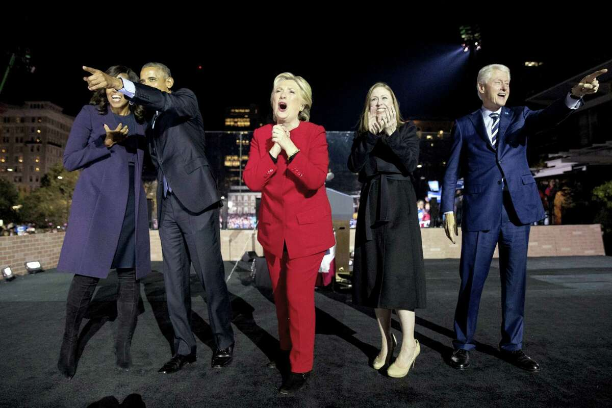 Democratic presidential candidate Hillary Clinton, center, is joined onstage by first lady Michelle Obama, left, President Barack Obama, second from left, Chelsea Clinton, second from right, and former President Bill Clinton, right, after speaking at a rally at Independence Mall in Philadelphia in 2016.