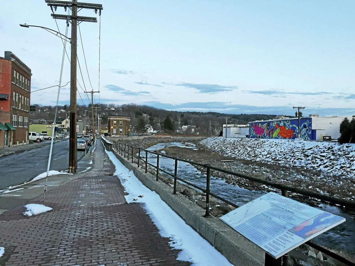"""The Naugatuck River, as seen Wednesday in Torrington near the """"Fish Tales"""" mural. A report on the Naugatuck Valley Greenway Trail, an ambitious development plan that would eventually connect Torrington to Derby, is now estimated to bring thousands of jobs and millions of consumer dollars to the region."""