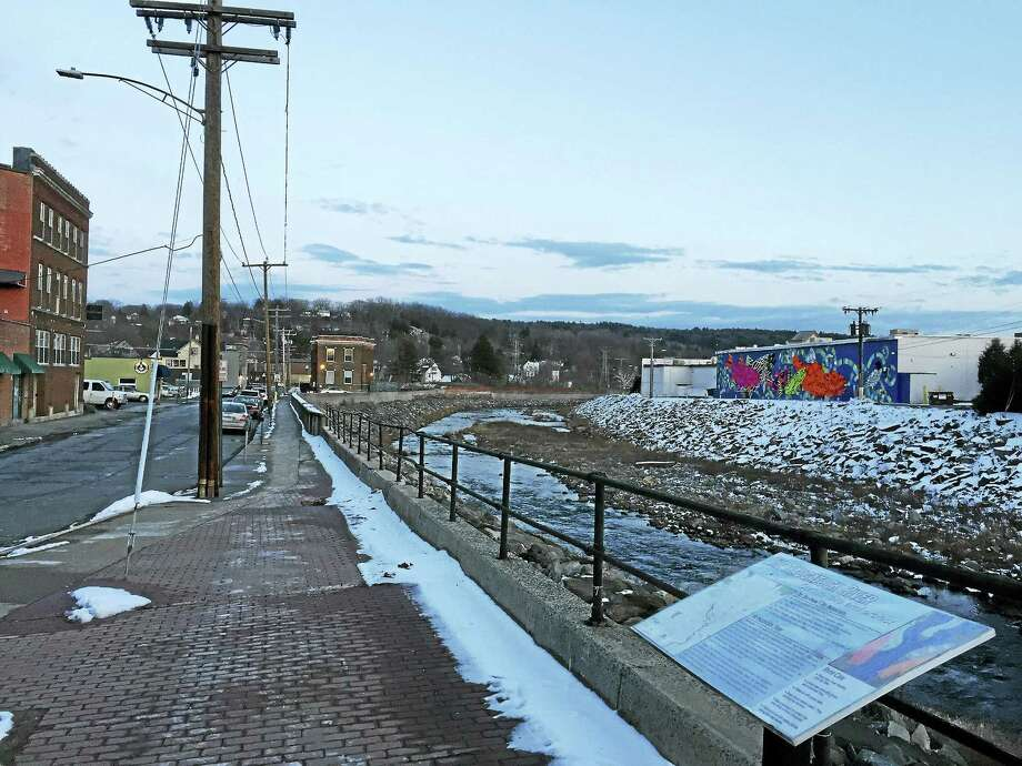"""The Naugatuck River, as seen Wednesday in Torrington near the """"Fish Tales"""" mural. A report on the Naugatuck Valley Greenway Trail, an ambitious development plan that would eventually connect Torrington to Derby, is now estimated to bring thousands of jobs and millions of consumer dollars to the region. Photo: Ben Lambert — The Register Citizen"""