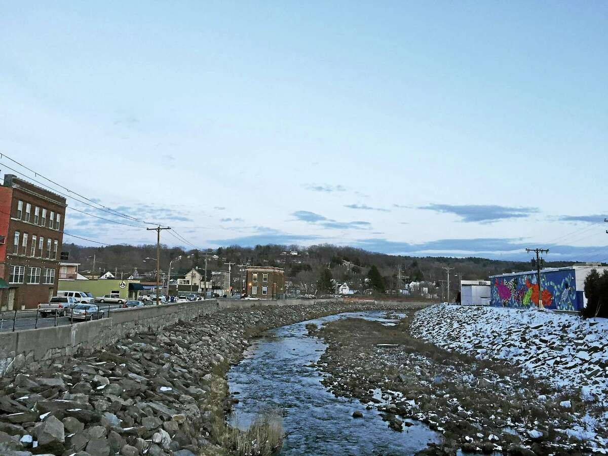 """The Naugatuck River, as seen Wednesday in Torrington near the """"Fish Tales"""" mural. A greenway trail along the river was the subject of a recent study that states it would bring jobs and consumer revenue to the region."""