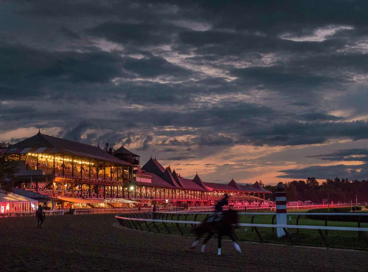 Shadowy images of horses working in the pre-dawn hours of the morning Friday Aug. 25, 2017 gives an eery effect at the Saratoga Race Course in Saratoga Springs, N.Y. (Skip Dickstein/Times Union)