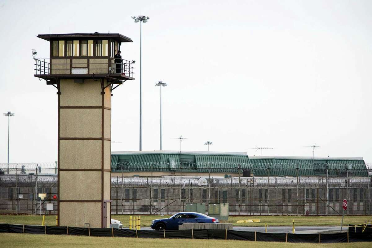 A prison guard stands at one of the towers at James T. Vaughn Correctional Center. All Delaware prisons went on lockdown on Wednesday due to a hostage situation unfolding at the James T. Vaughn Correctional Center in Smyrna, Del.