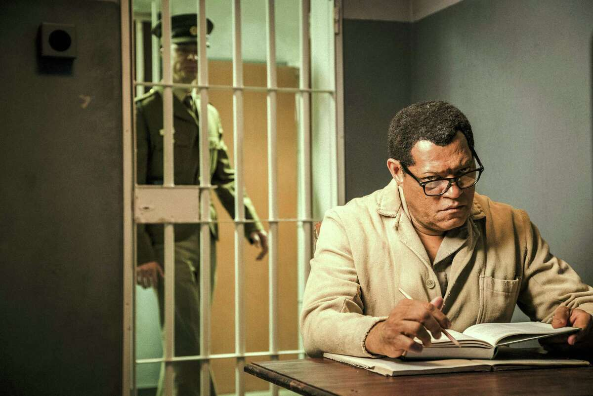 """This image released by BET shows Laurence Fishburne as Nelson Mandela in a scene from, """"Madiba,"""" a six-hour miniseries premiering on Feb. 1, 2017."""