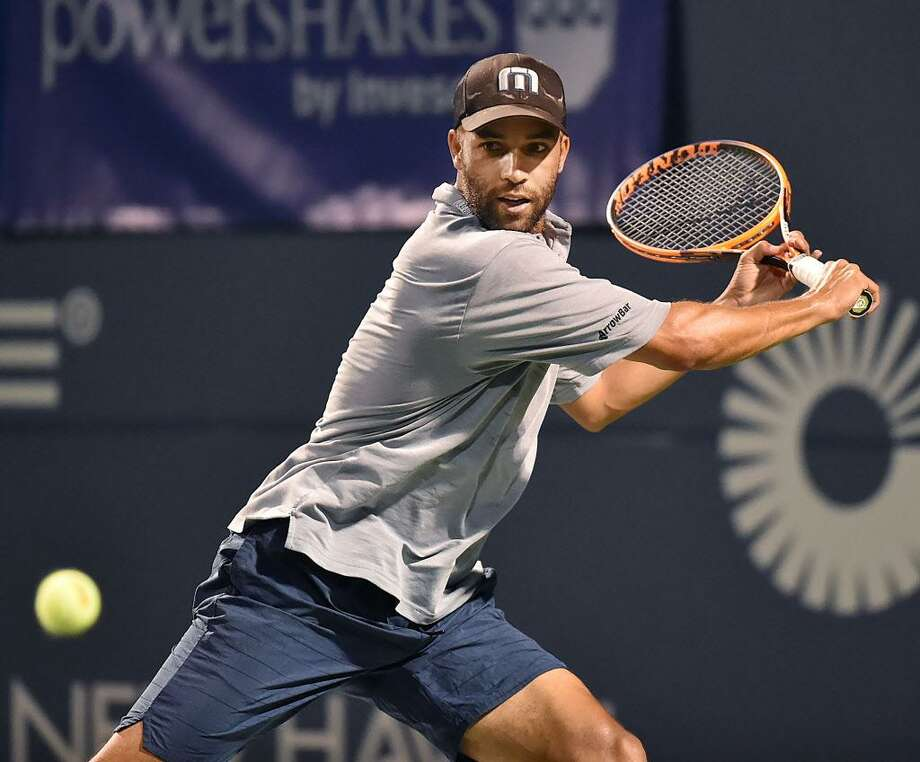 James Blake lines up a return against Mardy Fish, on Friday in the Men's Legends Event at the Connecticut Open in New Haven. Photo: Catherine Avalone / Hearst Connecticut Media / New Haven Register