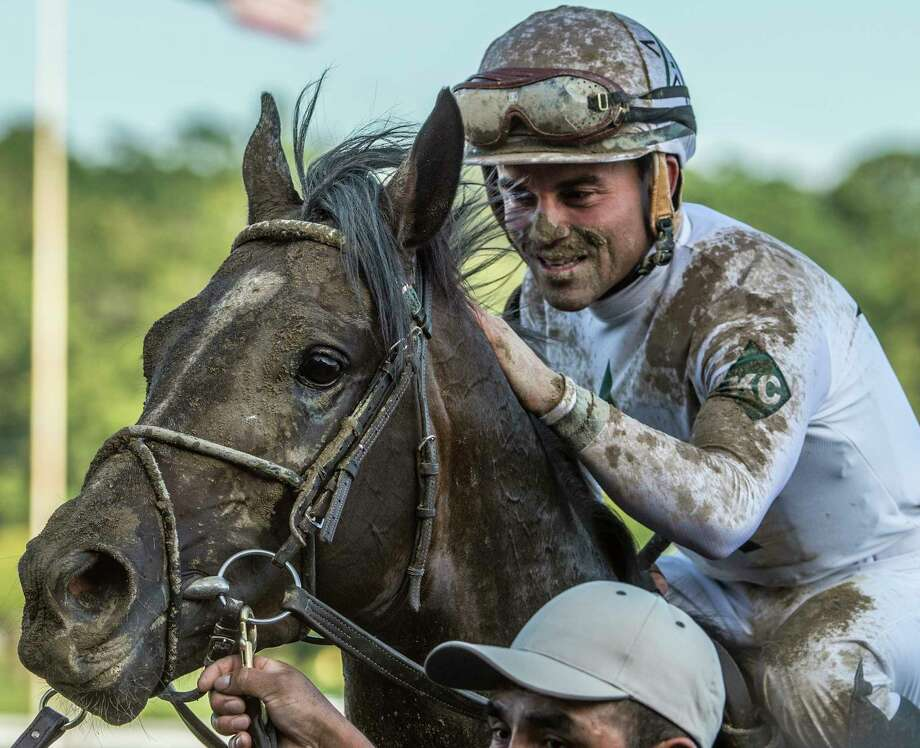 Jockey Joel Rosario gives Good Samaritan a pat on the neck after winning the 54th running of The Jim Dandy won by long shot  Saturday July 29, 2017 at the Saratoga Race Course  in Saratoga Springs, N.Y. (Skip Dickstein/Times Union) Photo: SKIP DICKSTEIN