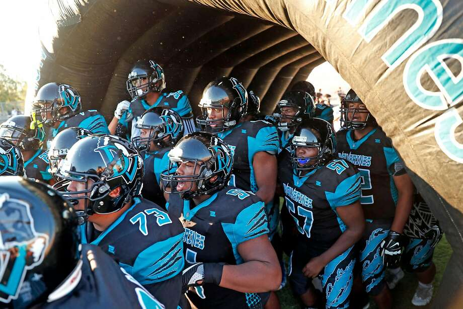 The Deer Valley High School football team takes the field before its 2017 season opener against Monte Vista-Danville in Antioch. Photo: Scott Strazzante / The Chronicle 2017
