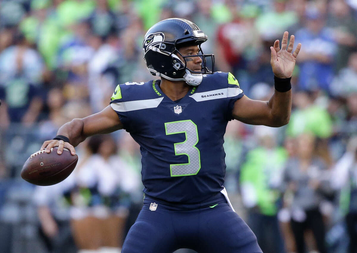 Seattle Seahawks quarterback Russell Wilson passes against the Kansas City Chiefs during the first half of an NFL football preseason game, Friday, Aug. 25, 2017, in Seattle. (AP Photo/Elaine Thompson) ORG XMIT: SEA109