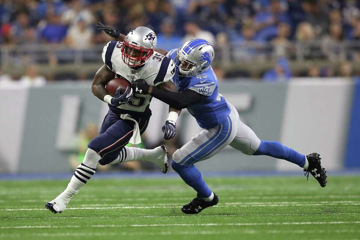 DETROIT, MI - AUGUST 25: Mike Gillislee #35 of the New England Patriots tries to escape the tackle of Charles Washington #45 of the Detroit Lions in the second quarter during a preseason game at Ford Field on August 25, 2017 in Detroit, Michigan. (Photo by Gregory Shamus/Getty Images) ORG XMIT: 700069847