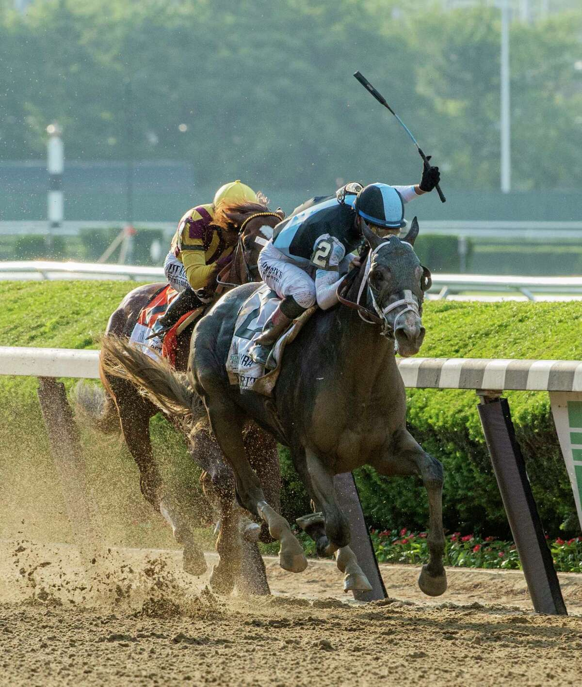 Tapwrit ridden by Jose Ortiz, passes Irish War Cry ridden by Rajiv Maragh to the win in the 149th running of the Belmont Stakes at Belmont Park June 10, 2017 in Elmont, N.Y. (Skip Dickstein/Times Union)