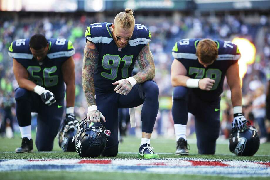 Seahawks players including Seahawks defensive lineman Cassius Marsh (center) pray before the start of the Seattle's preseason game against Kansas City, Friday, Aug. 25, 2017 at CenturyLink Field. Photo: GENNA MARTIN, SEATTLEPI.COM / SEATTLEPI.COM