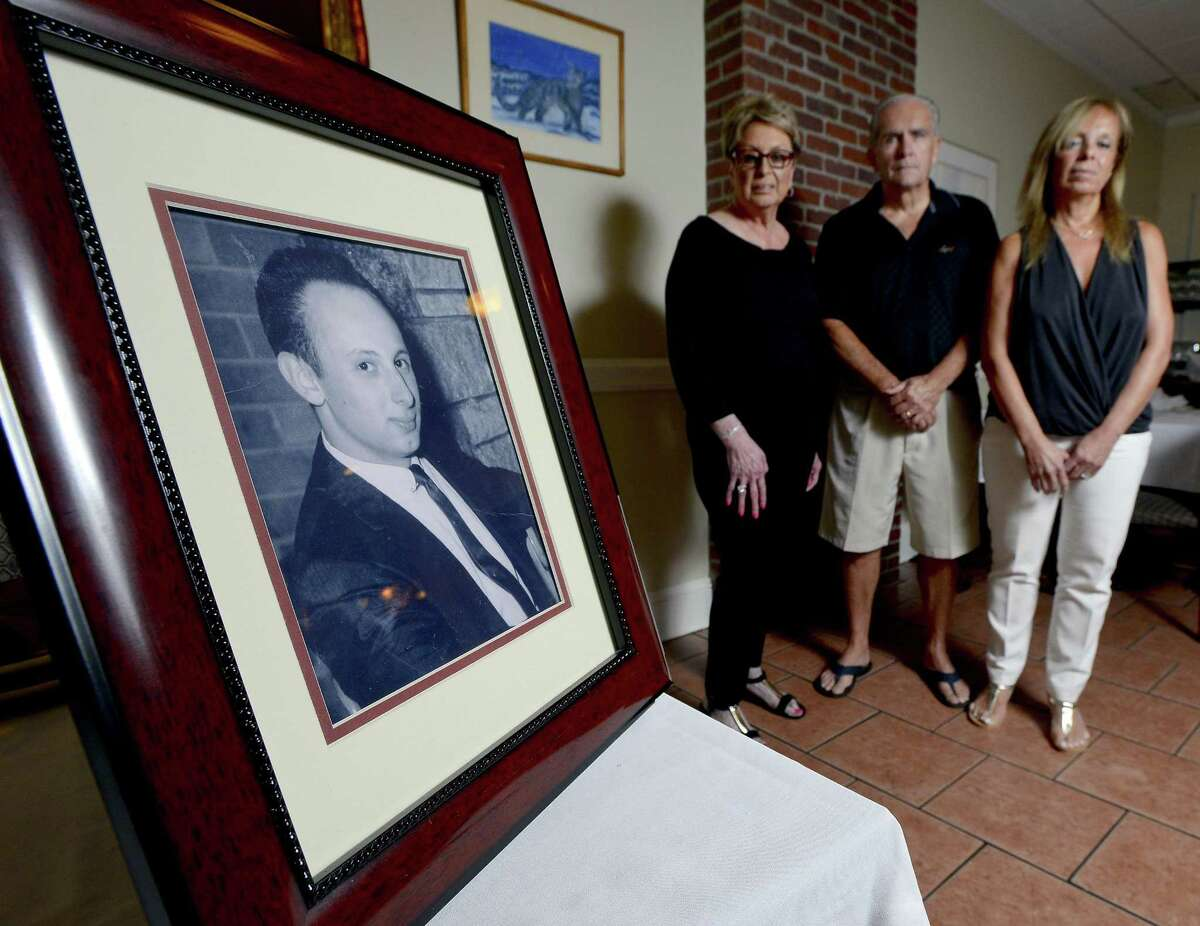"""A portrait of Joseph Pellicci is displayed at the family's West Side restaurant. His sisters, Fran Gross, right, and Toni Lupinacci, and her husband, Anthony """"Butch"""" Lupinacci, hope a proposed TV series sheds new light on Joseph Pellicci's unsolved murder. Below: Advocate newspaper clippings from when the murder occurred in 1973."""