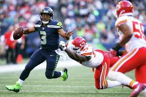 Seahawks quarterback Russell Wilson (3) scrambles towards the end zone  in the first half of Seattle's preseason game against Kansas City, Friday, Aug. 25, 2017 at CenturyLink Field.