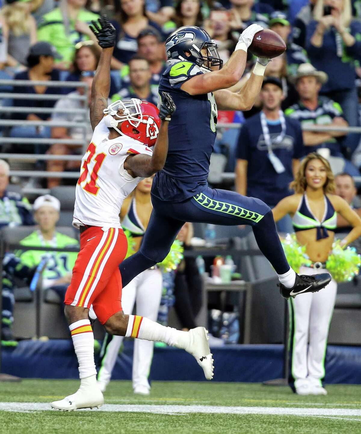 Seahawks wide receiver Tanner McEvoy catches a touch down pass over Chiefs player DeVante Bausby in the second half of Seattle's preseason game against Kansas City, Friday, Aug. 25, 2017 at CenturyLink Field.