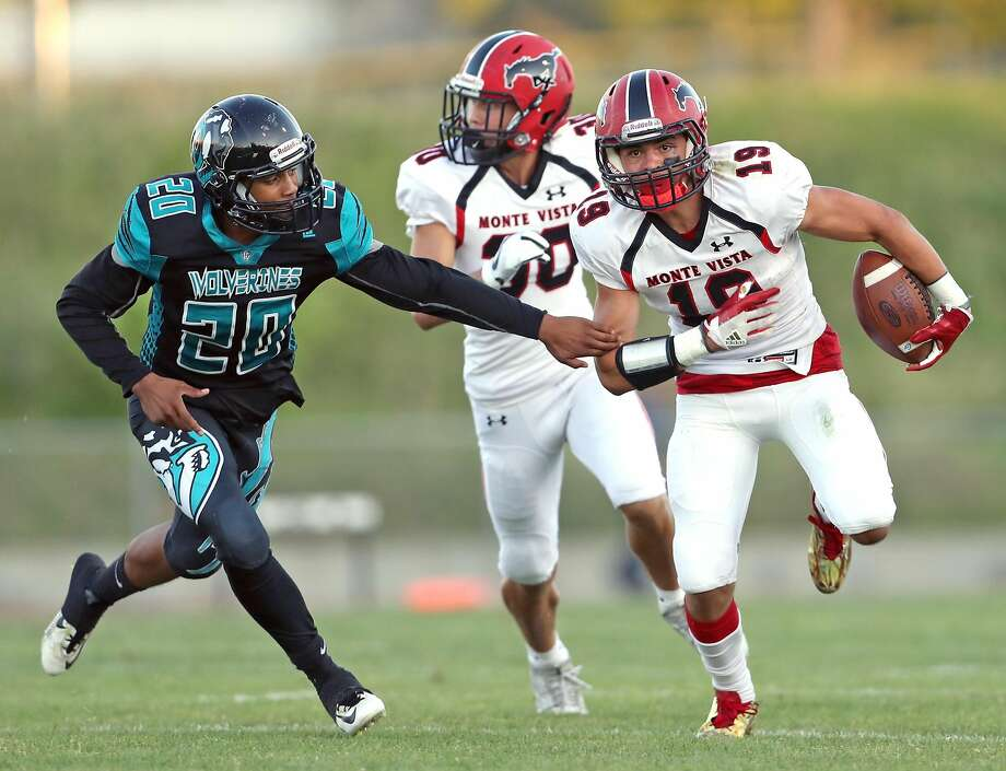 Monte Vista's Zane Cribb (19) runs away from Deer Valley's Joshua Scott (20) in 1st quarter  during high school football game in Antioch, Calif. on Friday, August 25, 2017. Photo: Scott Strazzante, The Chronicle