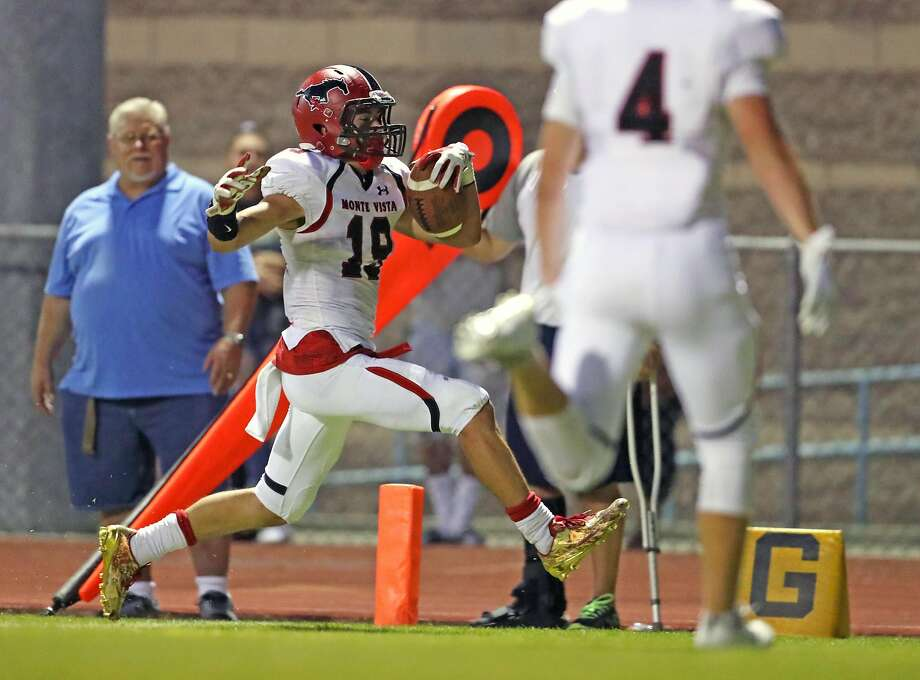 Monte Vista's Zane Cribb had three interceptions and scored on this 20-yard pass play in the second-quarter of the Mustangs' season-opening 13-7 defeat of Deer Valley-Antioch on Friday night. Photo: Scott Strazzante, The Chronicle
