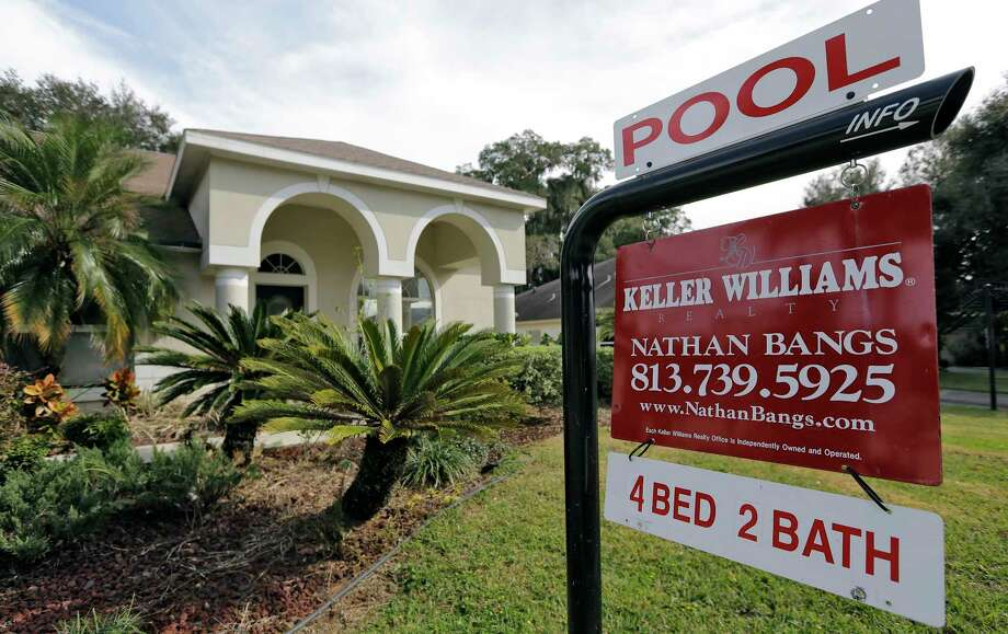A home for sale in Valrico, Fla. On Thursday, Aug. 24, 2017, the National Association of Realtors reports on sales of existing homes in July. (AP Photo/Chris O'Meara, File) Photo: Chris O'Meara, STF / Copyright 2017 The Associated Press. All rights reserved.
