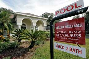 FILE - This Tuesday, Jan. 26, 2016, file photo shows an existing home for sale in Valrico, Fla. On Thursday, Aug. 24, 2017, the National Association of Realtors reports on sales of existing homes in July. (AP Photo/Chris O'Meara, File)