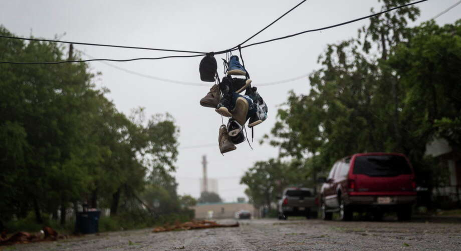 In Corpus Christi, shoes tied to a power line hung near a street after winds from Hurricane Harvey brought down a power pole. Photo: Nick Wagner, Associated Press / Austin American-Statesman