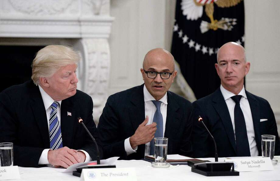 President Donald Trump, Microsoft CEO Satya Nadella, center, and Amazon CEO Jeff Bezos attend a meeting of the American Technology Council in June at the White House.  Photo: Olivier Douliery, MBR / Abaca Press