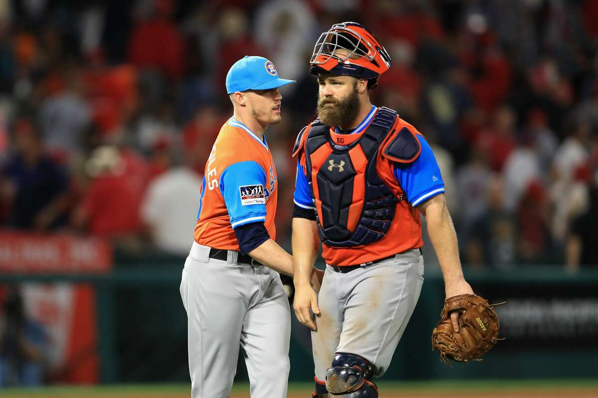 ANAHEIM, CA - AUGUST 25: Evan Gattis #11 and Ken Giles #53 of Houston Astros react after defeating the Los Angeles Angels of Anaheim 2-1 in a game at Angel Stadium of Anaheim on August 25, 2017 in Anaheim, California. (Photo by Sean M. Haffey/Getty Images)
