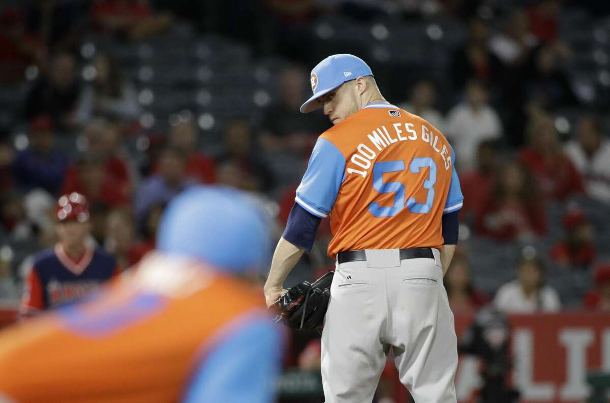 Houston Astros relief pitcher Ken Giles looks at first base during the ninth inning of a baseball game against the Los Angeles Angels, Friday, Aug. 25, 2017, in Anaheim, Calif. The Astros won 2-1. (AP Photo/Jae C. Hong)