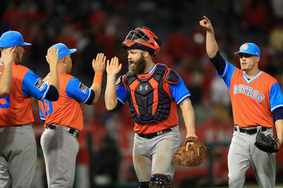 ANAHEIM, CA - AUGUST 25:  Evan Gattis #11 and Ken Giles #53 of Houston Astros react after defeating the Los Angeles Angels of Anaheim 2-1 in  a game at Angel Stadium of Anaheim on August 25, 2017 in Anaheim, California.  (Photo by Sean M. Haffey/Getty Images) Photo: Sean M. Haffey/Getty Images