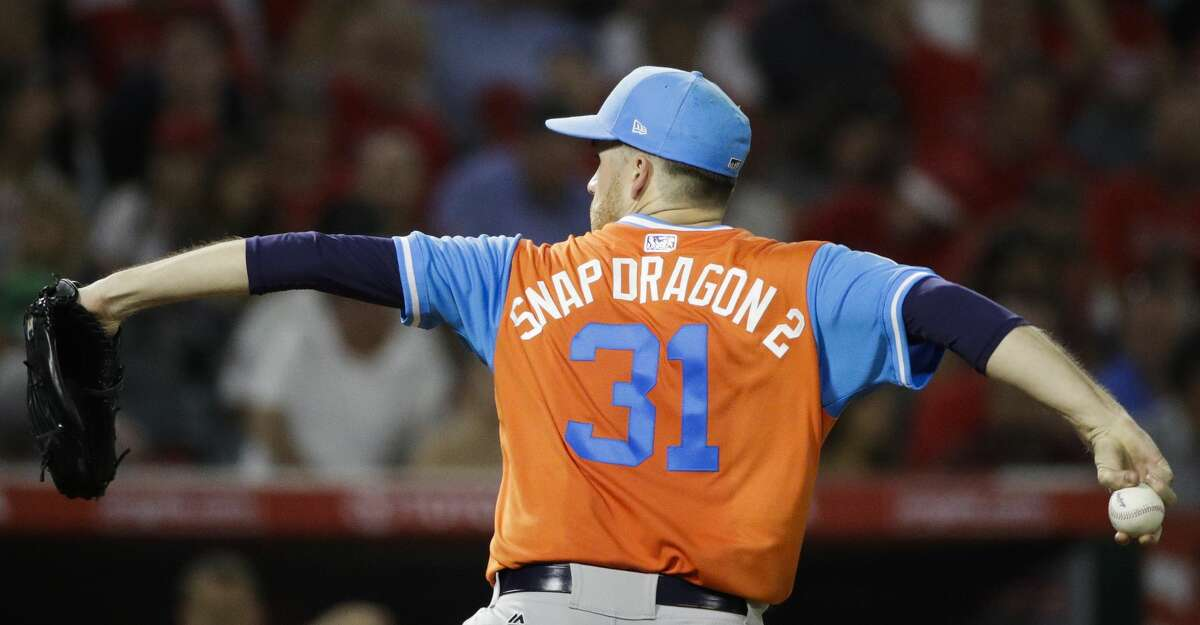 Houston Astros starting pitcher Collin McHugh throws against the Los Angeles Angels during the fourth inning of a baseball game, Friday, Aug. 25, 2017, in Anaheim, Calif. (AP Photo/Jae C. Hong)