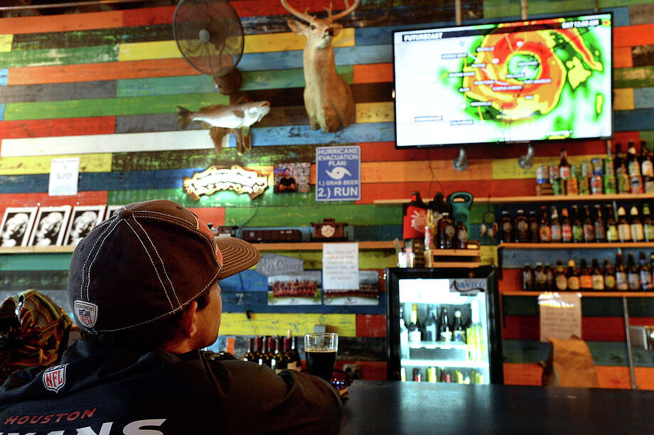 Like many businesses throughout the area, televisions at the Neches Brewing Company were tuned to a steady stream of weather forecasts, tracking Hurricane Harvey's approach and any damage to be reported. Residents, businesses and city crews throughout the region continue to brace for Hurricane Harvey Friday. Photo taken Friday, August 25, 2017 Kim Brent/The Enterprise Photo: Kim Brent, Beaumont Enterprise / BEN