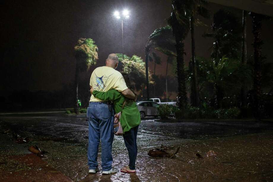 To stay or go? In this photo: Tony Buchanan and Myava Buchanan, who evacuated from Aransas Pass, Texas, stand outside a Corpus Christi hotel during Hurricane Harvey on Aug. 25, 2017. Photo: TAMIR KALIFA, NYT / NYTNS