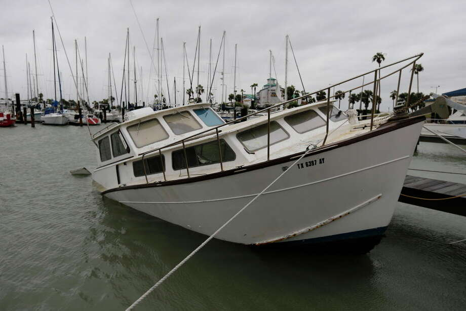 A boat appears partially sunk in the water in the municipal marina in Corpus Christi on Saturday, Aug. 26, 2017 after Hurricane Harvey - a category 4 storm - ripped through the area overnight. Photo: Kin Man Hui, San Antonio Express-News / ©2017 San Antonio Express-News
