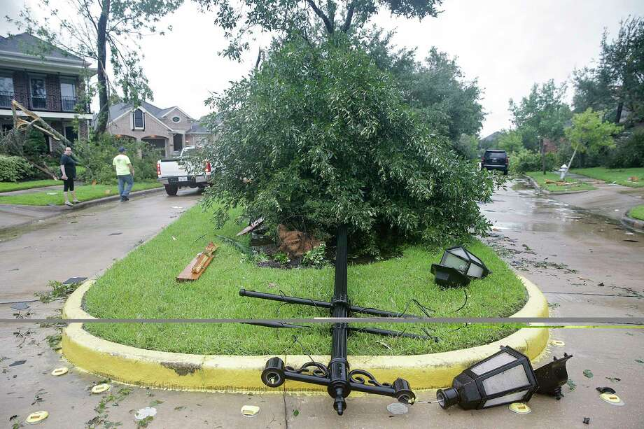 A street light knocked down from what is believed to be a tornado touchdown in Sienna Plantation as a result of Hurricane Harvey on  Saturday, Aug. 26, 2017. Photo: Elizabeth Conley, Houston Chronicle / © 2017 Houston Chronicle