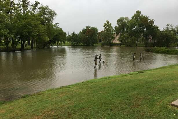 Flooding along Sienna Parkway at the lake near The Learning Experience center in Sienna Plantation.