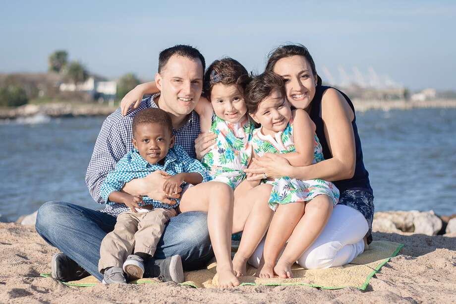 Johnny and Paola Fusilier with their oldest three children. They haven't had a chance to take a family picture with all six members.