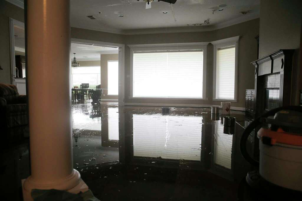 Rain Water Falls On The Second Floor At Ellis Home In Sienna Plantation As