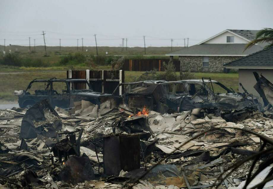 A burnt out house and cars that caught fire are seen after Hurricane Harvey hit Corpus Christi, Texas on August 26, 2017.   Hurricane Harvey slammed into the Texas coast late Friday, unleashing torrents of rain and packing powerful winds, the first major storm to hit the US mainland in 12 years. / AFP PHOTO / MARK RALSTONMARK RALSTON/AFP/Getty Images Photo: MARK RALSTON, AFP/Getty Images / AFP or licensors