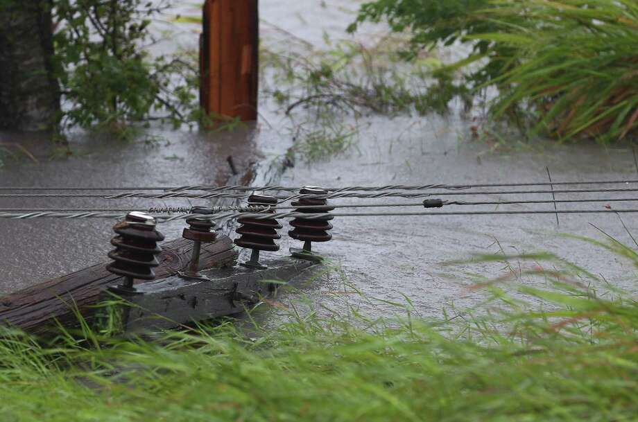 After Harvey, downed electric lines in floodwater -- like this one in Jackson County -- threatened electrocution.  Photo: Godofredo A. Vasquez, Houston Chronicle / Houston Chronicle