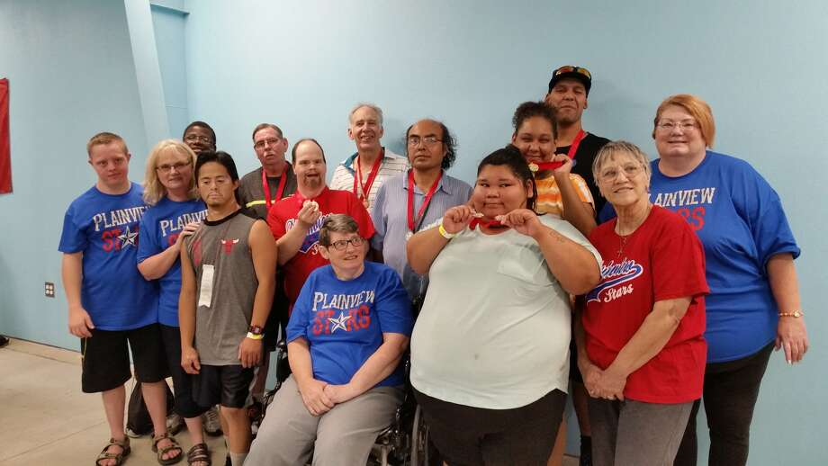 Athletes and coaches from the Plainview Stars Special Olympics Team at the Area 17 Aquatics Competition in Lubbock on Aug. 19 include Raymond Quintanilla (front left), cheerleader Diane McDonough, Lorraine Barrientos, Jared Ball (middle row left), Head Coach Jackie Ball, Tracy Poole, Jessie Tambunga, Donnicia Bremby, volunteer Janet Poole, Danny Potts (back left), Ronnie Price, Lynn Mason, Donnie Matsler and Coach Beverly McDonough.