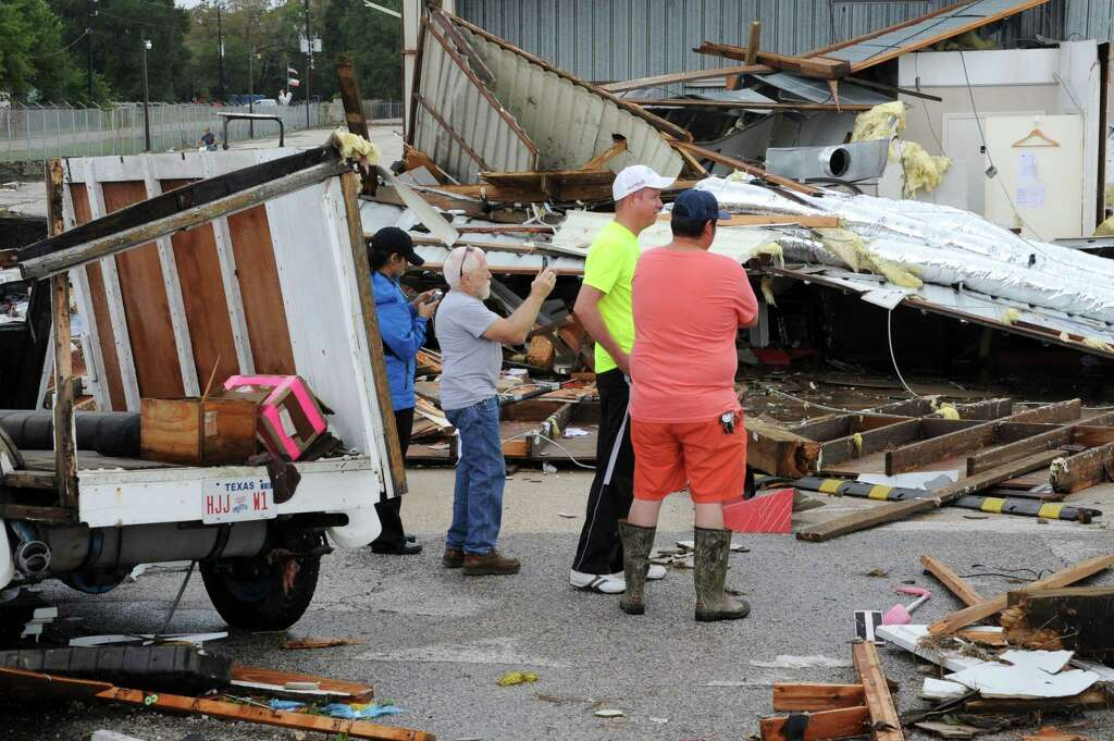 People Survey Storm Damage At A Trailer Storage Facility Near I 10 And FM1463 In
