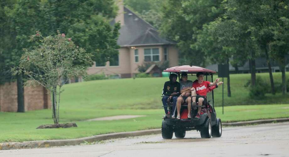 You will develop a strange desire to purchase a golf cart and drive it around your subdivision.  Photo: Elizabeth Conley, Houston Chronicle / © 2017 Houston Chronicle