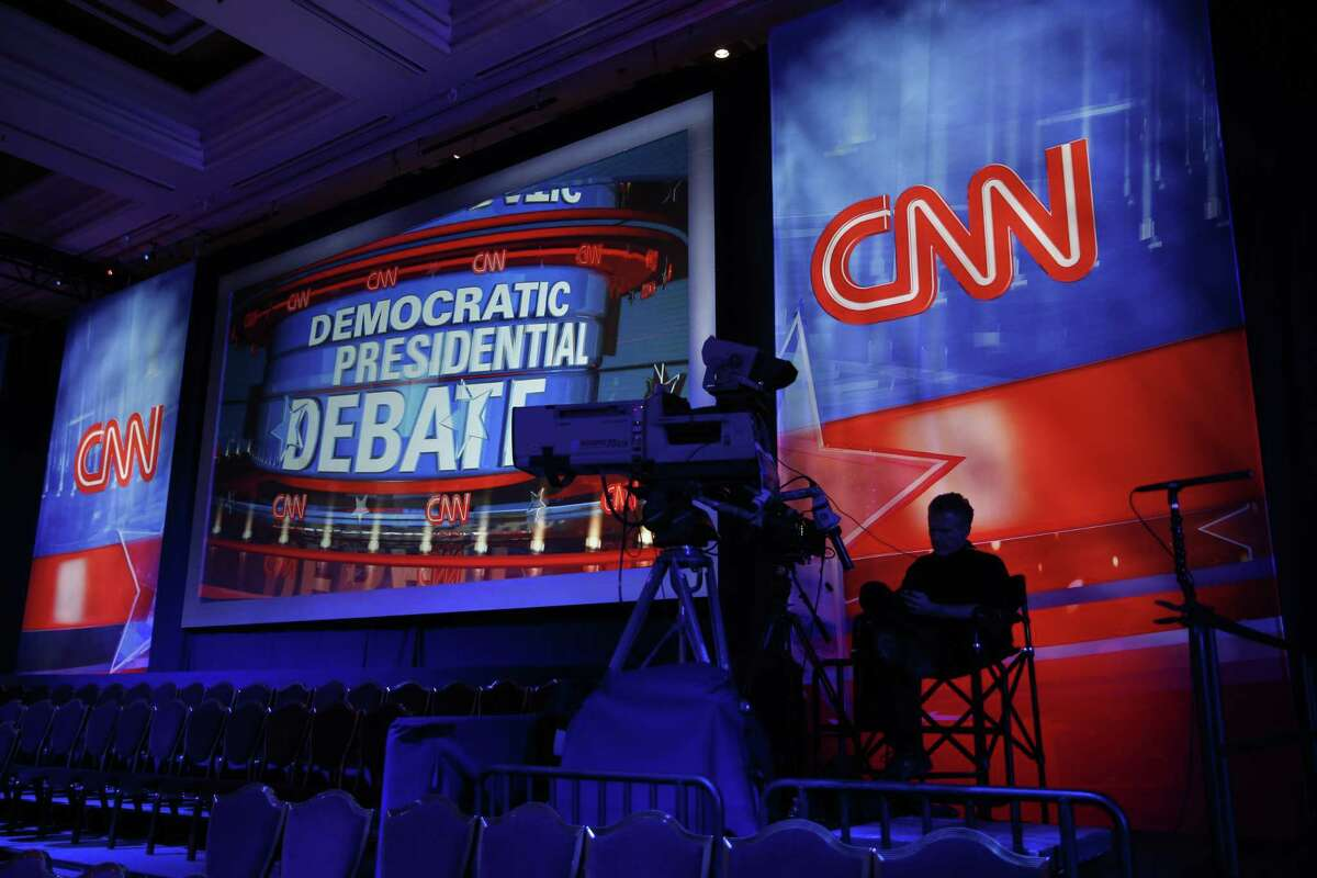 A camera operator waits in the debate hall before a CNN Democratic presidential debate Tuesday in Las Vegas. Democratic presidential candidates, Hillary Rodham Clinton, Jim Webb, Bernie Sanders, Lincoln Chafee, and Martin O'Malley will take the stage later today.