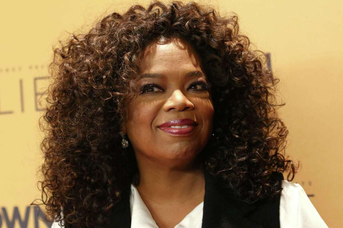 """In this Oct. 14, 2015 photo, Oprah Winfrey attends the premiere of the Oprah Winfrey Network's (OWN) documentary series """"Belief,"""" at The TimesCenter in New York. Weight Watchers announced on Oct. 19, 2015 that Winfrey is taking an approximately 10 percent stake in Weight Watchers for about $43.2 million and joining the weight management company's board."""