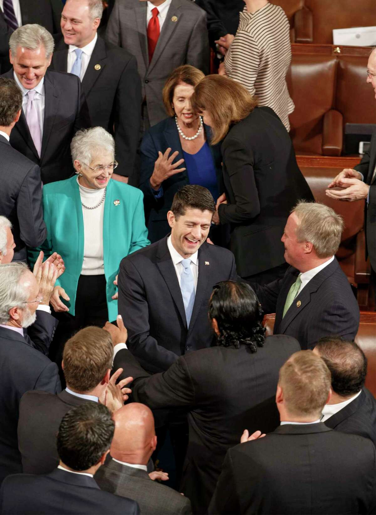 Newly elected House Speaker Paul Ryan, R-Wis., (center) smiles as he is welcomed to the House Chamber on Capitol Hill in Washington on Oct. 29, 2015, following the resignation of John Boehner.