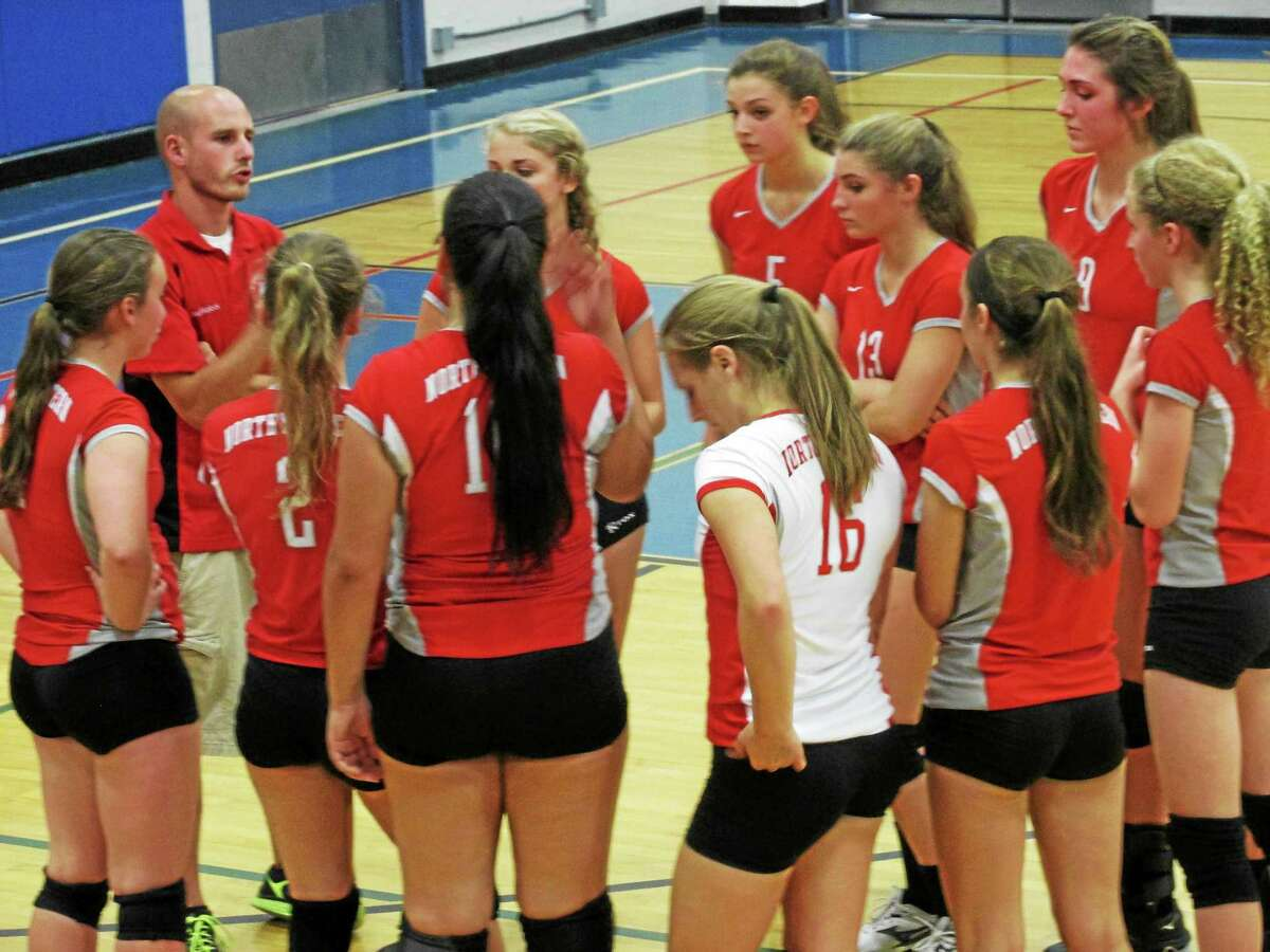 Northwestern Coach Jon Hurlock gets his players ready in the Highlanders' sweep at Lewis Mills Tuesday evening.